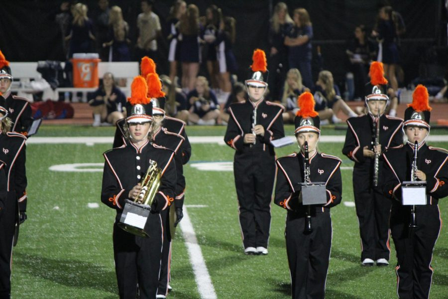 PERFECTLY POISED, the BPHS marching band performs during a home football game.