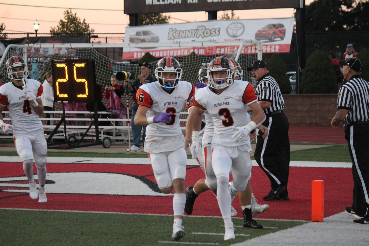 FIRED UP,  Sean McGowan leads the celebratory run after his 32-yard touchdown run during the Hawks game against Moon on September 28.