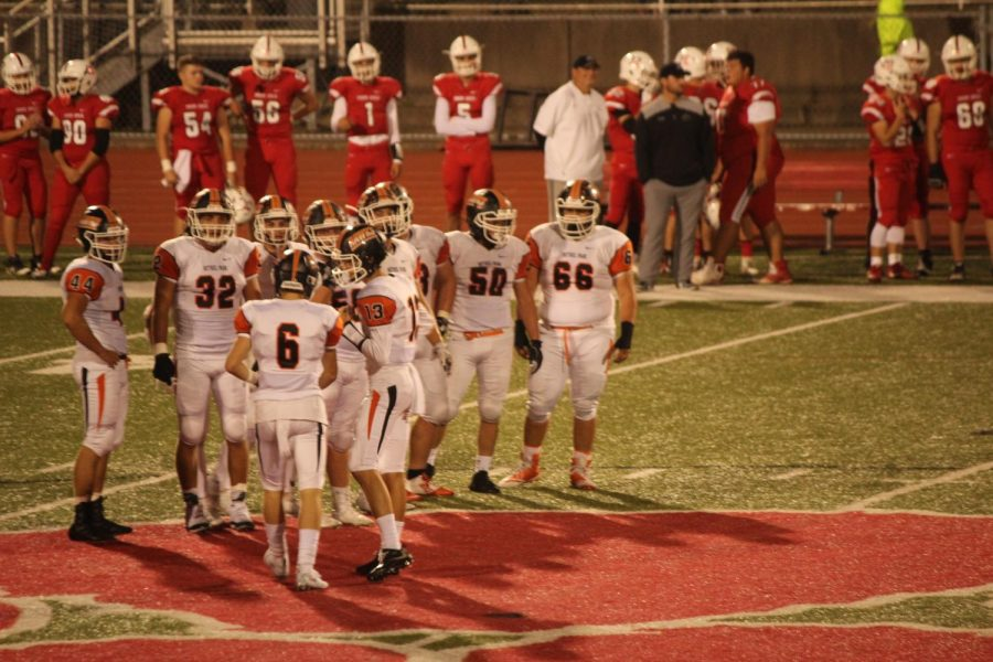 HERE'S THE PLAN... quarterback Anthony Chiccitt tells the offense the play call