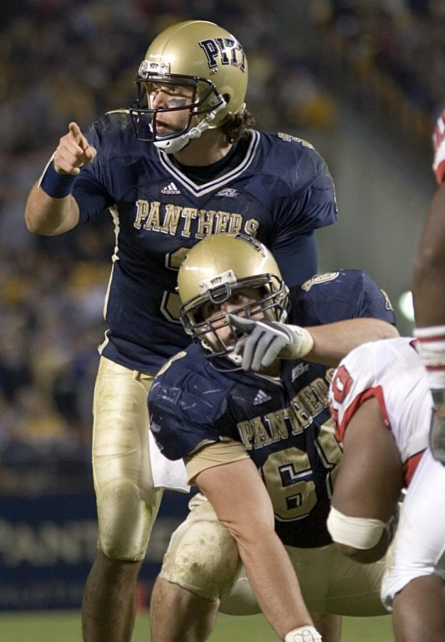 21+October+2006%3A+Pitt+quarterback+Tyler+Palko+and+center+Joe+Villani+point+at+defenders.+The+Rutgers+Scarlet+Knights+defeated+the+Pitt+Panthers+20-10+on+October+21%2C+2006+at+Heinz+Field%2C+Pittsburgh%2C+Pennsylvania.%09
