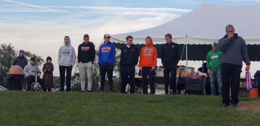 IN THE BLISTERY COLD, Antonio Burkhart and Eli Allridge stand with other WPIAL place-winners.