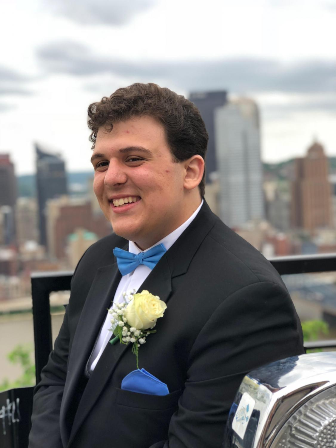 CHEESIN' ON MOUNT WASHINGTON, Ben Hultz smiles for the camera before the 2018 prom.