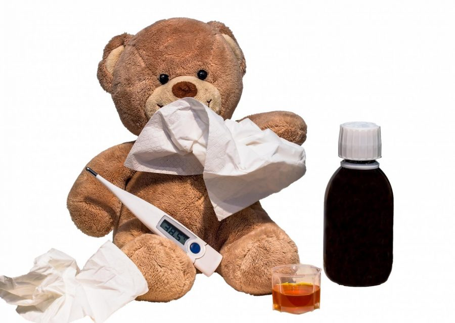 Teddy+bear+concept+for+cold+and+flu+season+with+thermometer%2C+tissues+and+medication