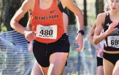 Cross country star Emily Carter medals at States