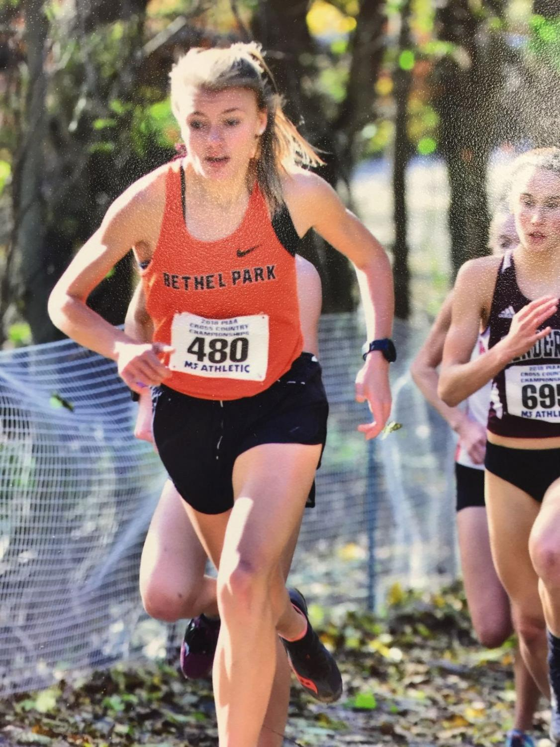 FOCUSED, Emily Carter races in the State Championship meet at Hershey on Nov. 3.