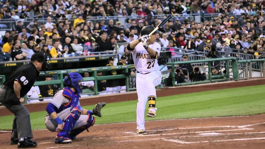 Pirates+3rd+baseman+Jung-Ho+Kang+batting+in+a+game+against+the+Cubs.