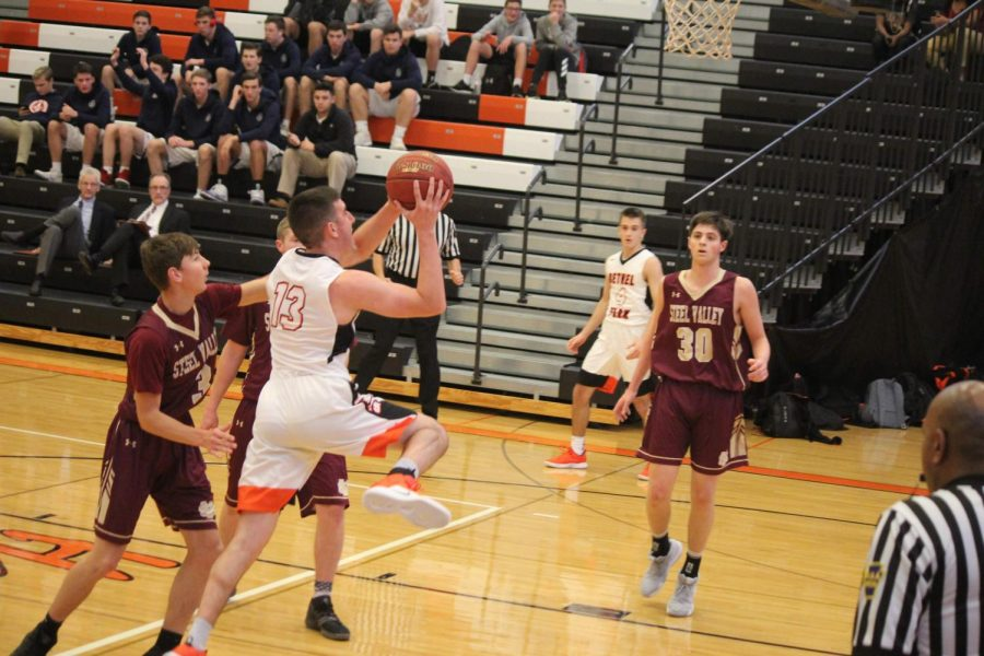 EYES+ON+THE+NET%2C+Alex+Mullen+shoots+a+layup+in+the+Hawks%27+game+against+Steel+Valley+on+Friday%2C+Dec.+7.