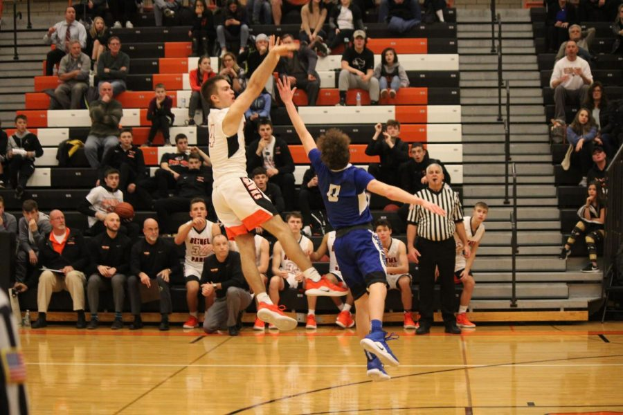 WITH THE FADE-AWAY, Ryan Meis beats the buzzer to give the Hawks the win!