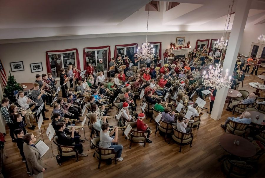PLAYING CHRISTMAS TUNES, the Bethel Park Brass Day members have fun spreading some joy.