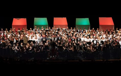 ALL TOGETHER, all of the ensembles who performed in the winter concert sing peacefully on stage with some BPHS alumni.