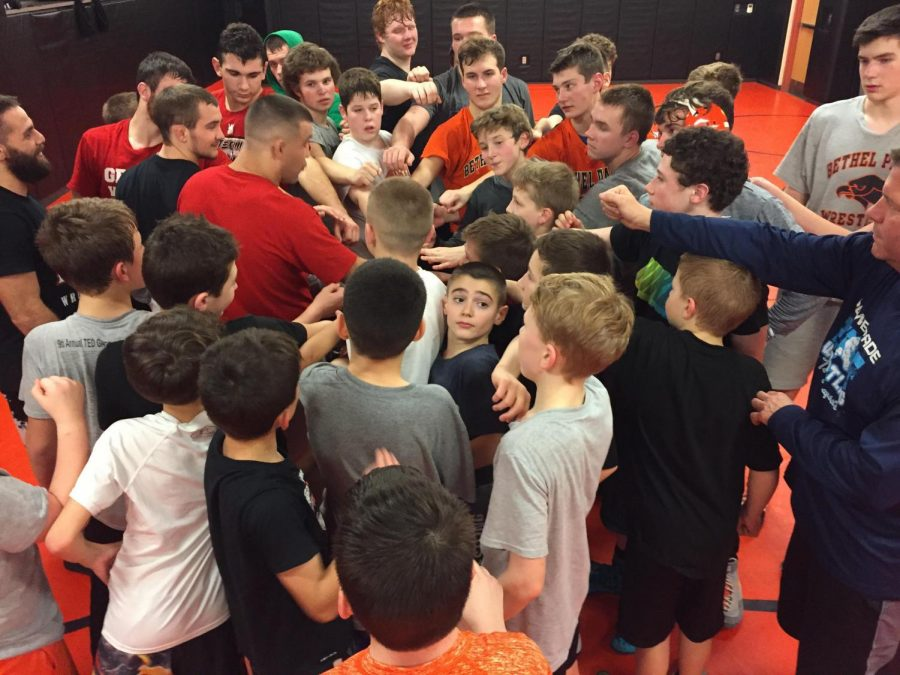 IN UNITY, the Varsity, Junior High, and rec wrestlers break it out after a Tyler Nauman wrestling clinic.