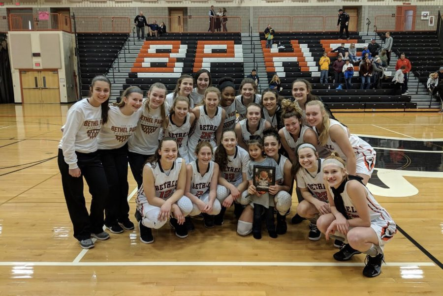 Girls basketball team is all smiles after their championship win.