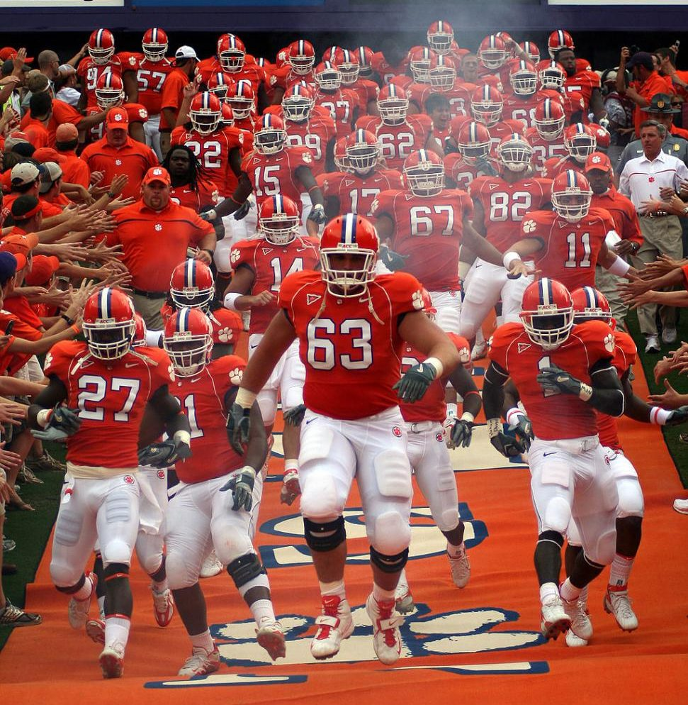 Clemson Tigers football team runs down the field at the start of the game on September 24, 2006.