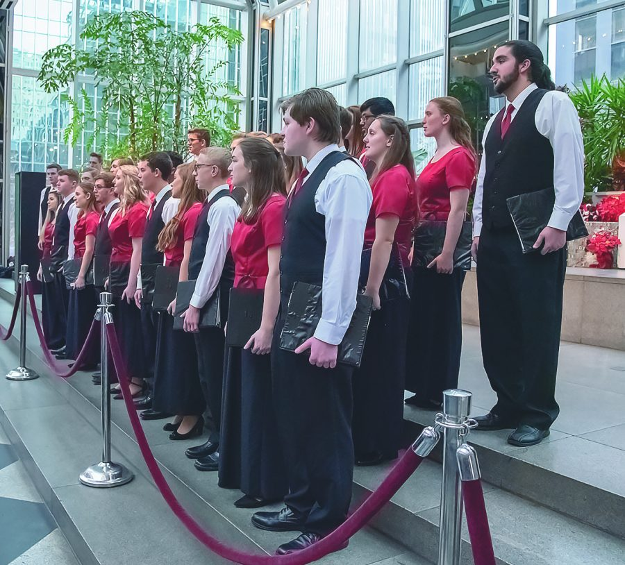 WAITING TO BE CONDUCTED, Bethel Park Top 21 is ready to sing at the PPG Winter Garden.