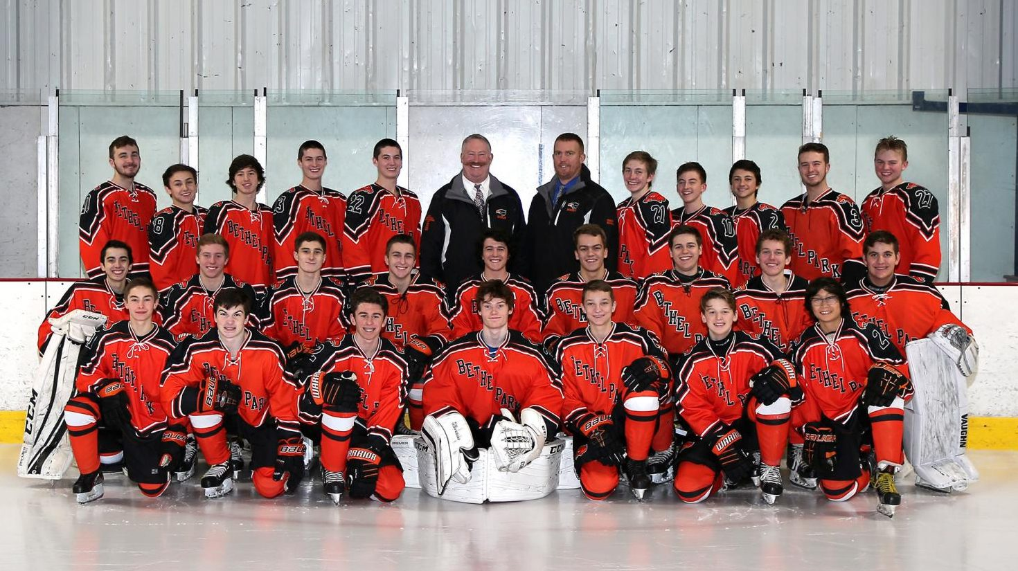 Varsity hockey team poses for a pic.