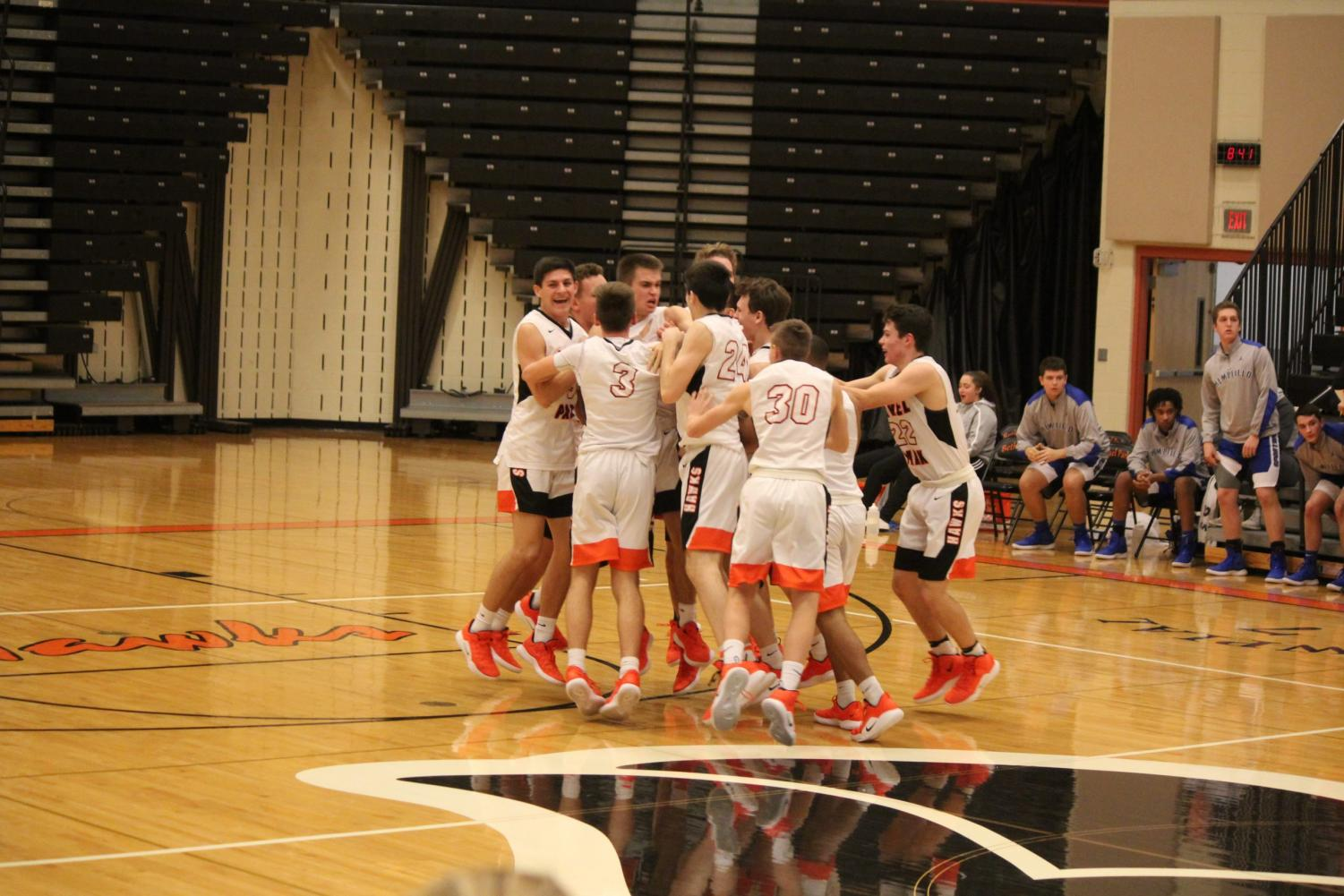 Hawks celebrate after their buzzer-beater victory over Hempfield on Dec. 19.