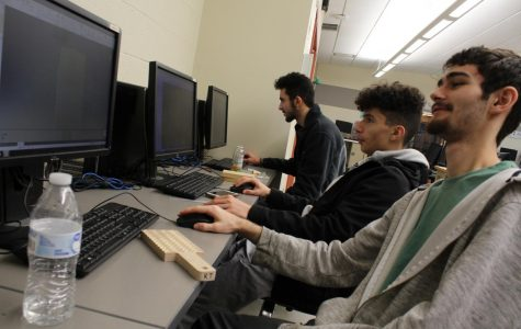 CIM students work with Autodesk Inventor software.