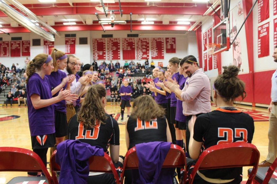 Lady Hawks prepare to make their way through the team tunnel onto the court before their game against Peters Township on Monday, Jan. 28.