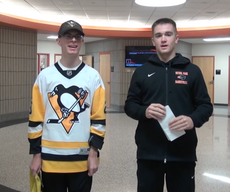 "Host Ryan Meis stands with guest Tyler Schultz ""The Biggest Pens Fan in the Country."""