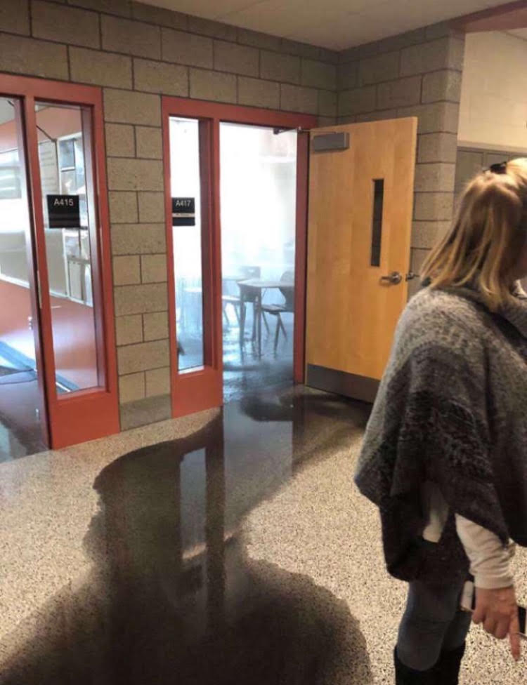 A student gets a snapshot of what happened to Mr. Pierson's room on Tuesday, Jan. 22, showing what appeared to be an unknown black liquid seeping from his room.