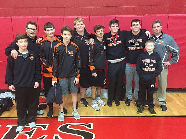 HAWK PRIDE IS REAL as the wrestlers pose for a group pic at the Southmoreland Tournament after Luke Montgomery was crowned champion.