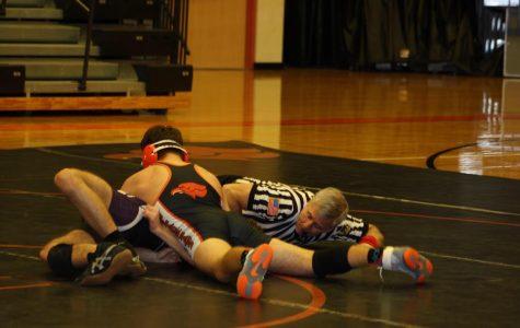 Hawks wrestling snags big win over Highlanders on Youth Night