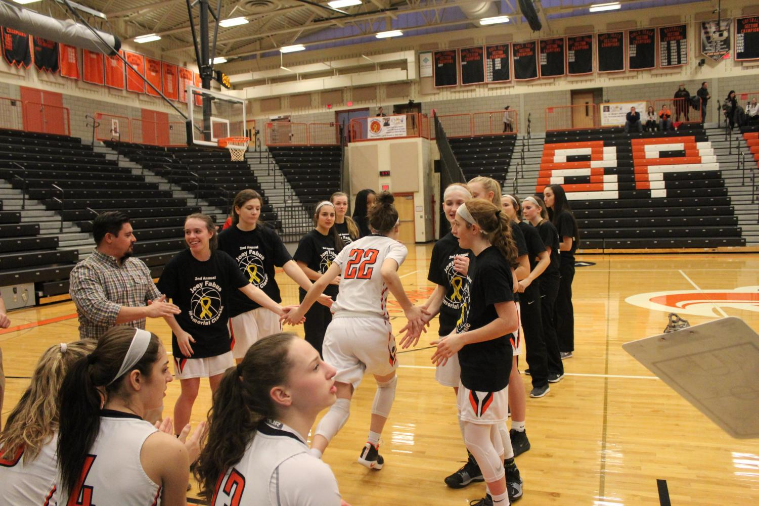 Olivia Westphal makes her way through the team tunnel during introductions to the Lady Hawks' game vs. West A on Jan. 26.
