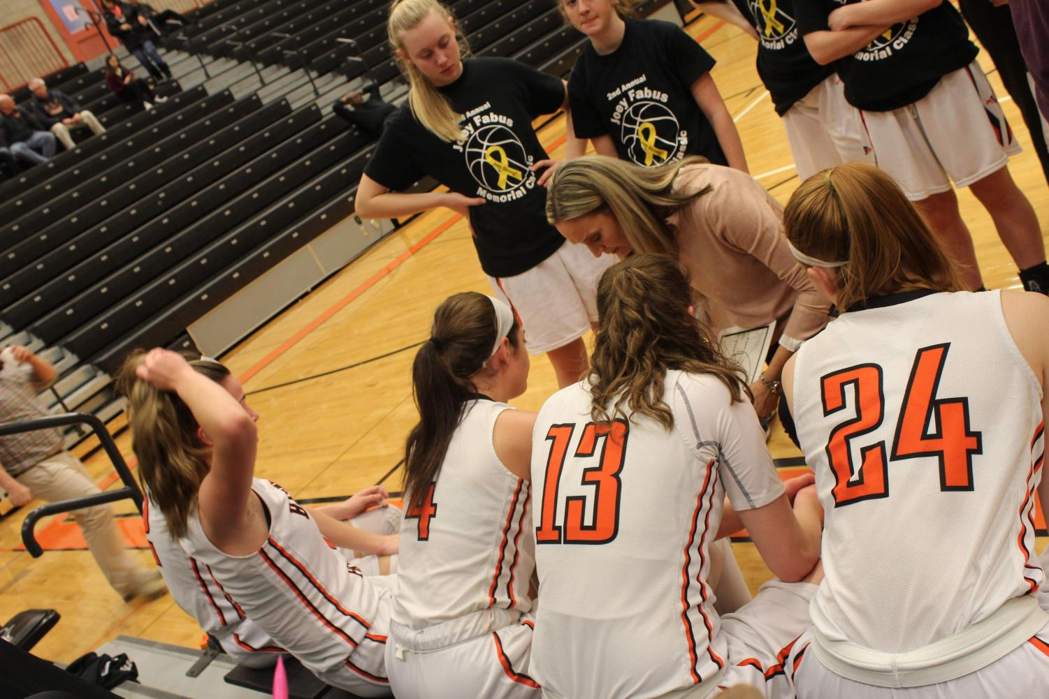 Head Coach Jonna Burke discusses strategy with her Lady Hawks during their game against West Allegheny on Jan. 26.