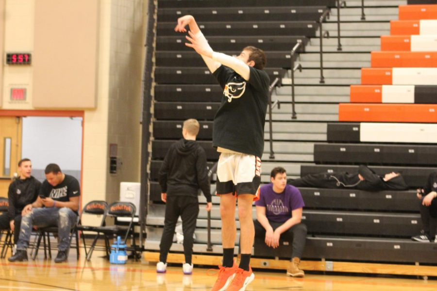 Logan Wright SCORES a three in warm-ups before the team plays Baldwin.