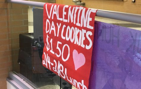 A sign in the lobby above the cafe reminds students to send a cookie to their valentine.