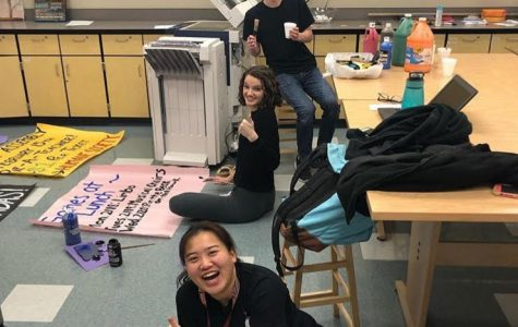 Senior Rosie Dailey, junior Grace Bair, and senior Anthony Lucchitti work on posters for SGA's Wish Week and Spirit Week. SGA posted this photo on their Instagram.