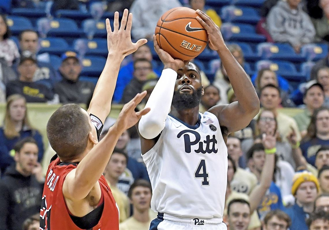 Pitt forward Jared Wilson-Frame gets a 3-point shot up against VMI in the first half Friday, Nov. 9, 2018 at Petersen Events Center.