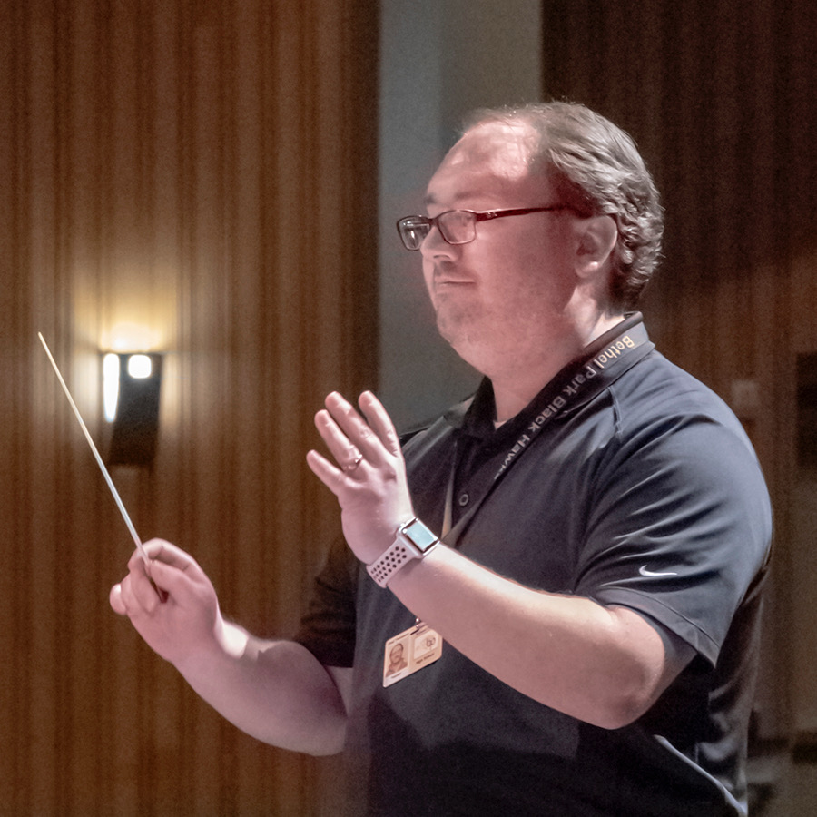 With+his+arms+raised%2C+director+of+the+Bethel+Park+High+School+Symphonic+Band%2C+Mr.+Thomspon%2C+conducts+the+group.
