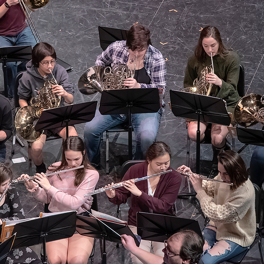 Playing+nicely%2C+the+BPHS+Symphonic+band+flutes+and+frenchhorns+play+nicely+in+sinc.