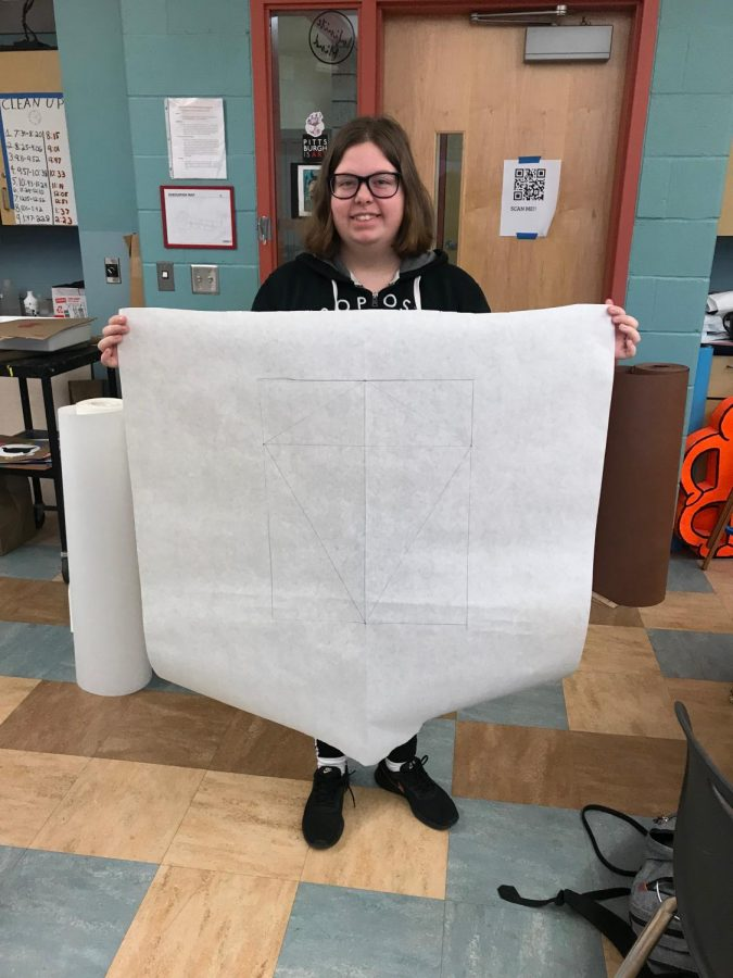 ERIN DUBLIN of Mr. Wallisch's art class showcases her symmetrically finished sketch of a kite.