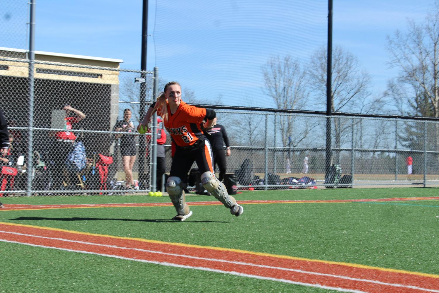 Catcher Shayna Postler aims to throw to first during the Lady Hawks' game vs. Peters on Wednesday, March 27.