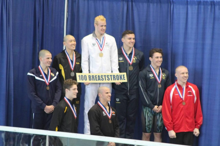 Junior+Paul+Kallaur+stands+proudly+in+8th+place+in+100-meter+breaststroke+at+the+WPIAL+Championships.