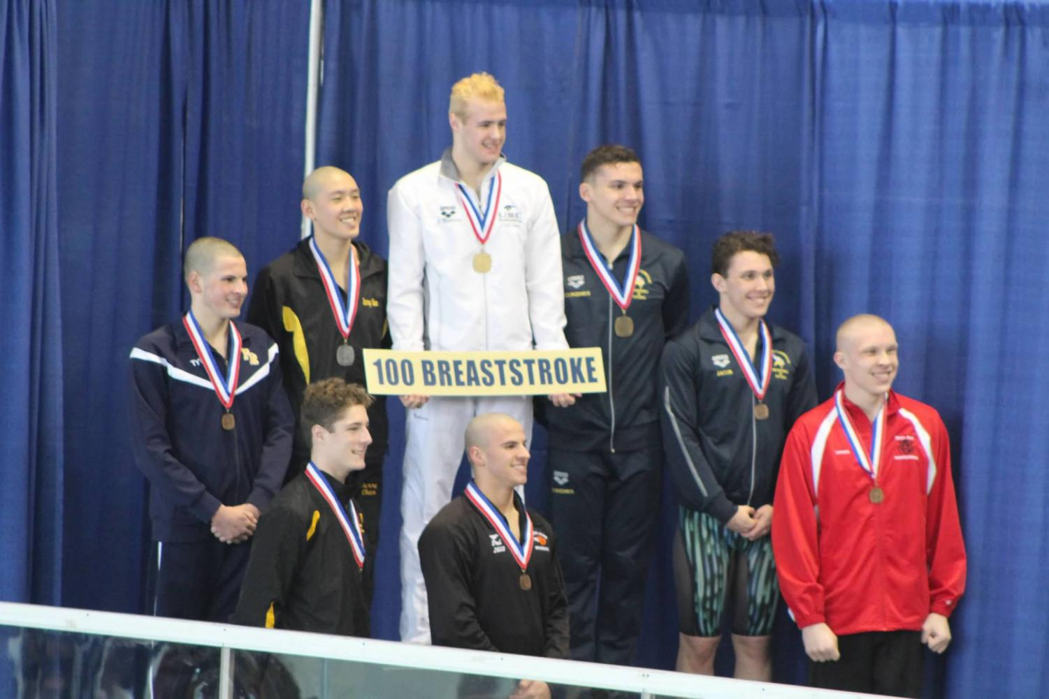Junior Paul Kallaur stands proudly in 8th place in 100-meter breaststroke at the WPIAL Championships.