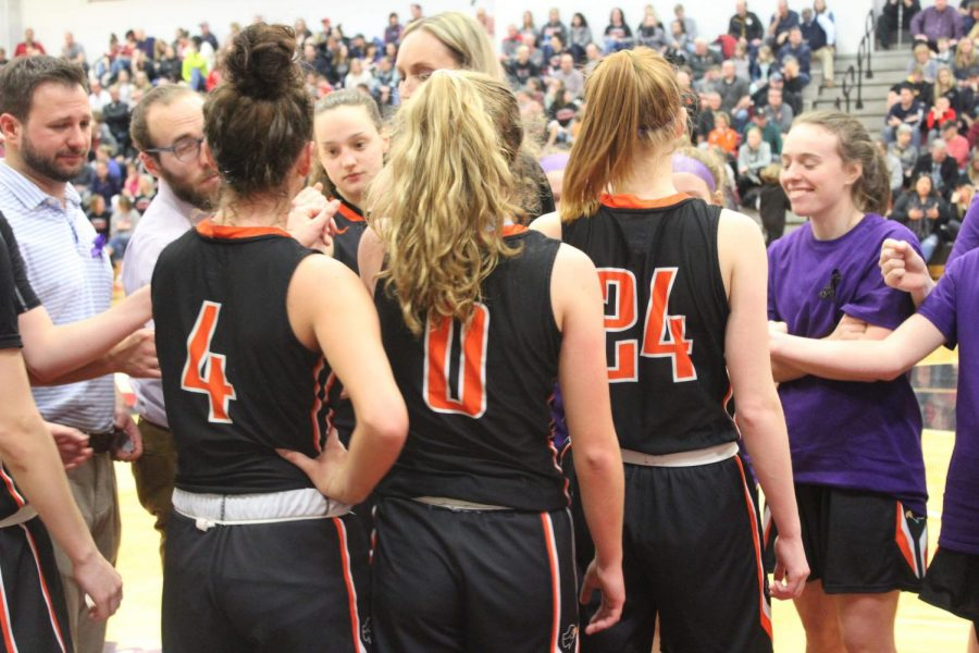 Lady Hawks huddle up during their game against Peters on Jan. 28.