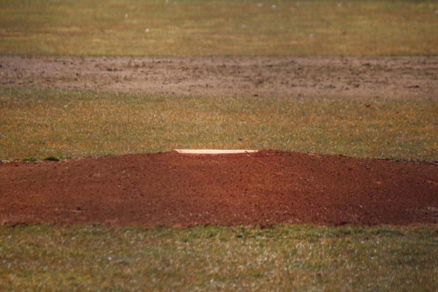 The+pitching+mound+at+Purkey+Field+lies+in+focus+while+a+messy+infield+is+seen+in+the+background+on+Wednesday%2C+March+27%2C+a+day+after+rain.