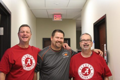 Mr. Knapp (far right), poses with Mr. Bruce (far left), and Mr. Jones (middle).