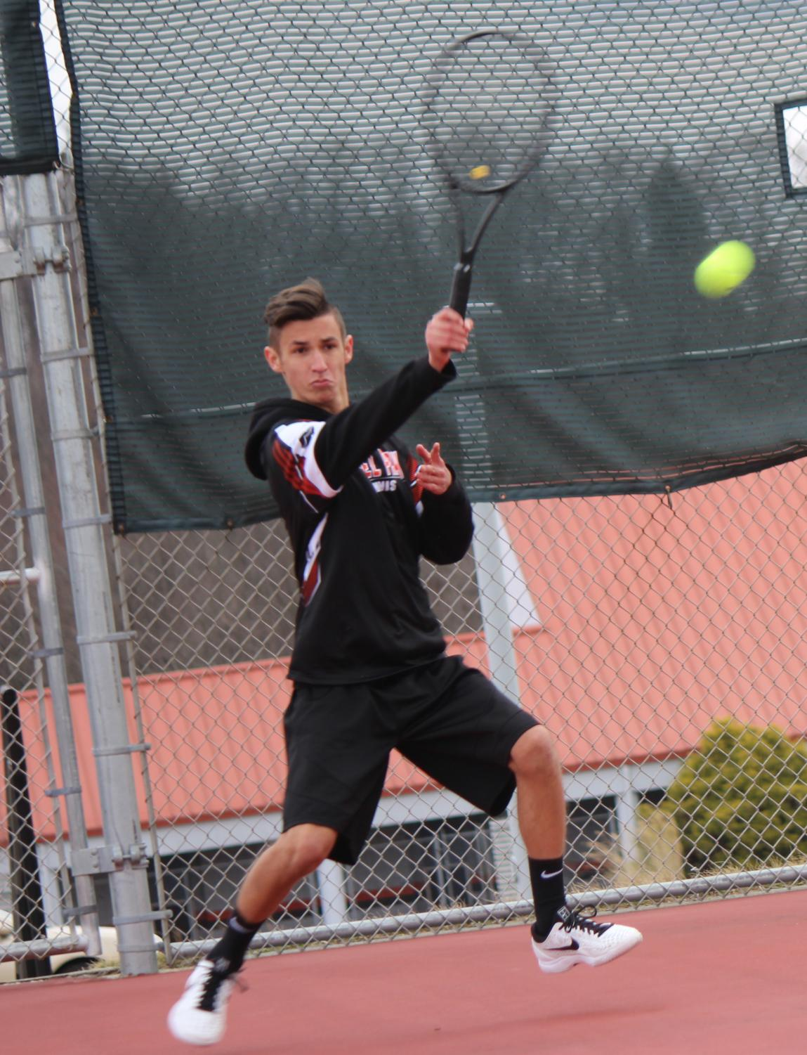 James+hitting+a+forehand+