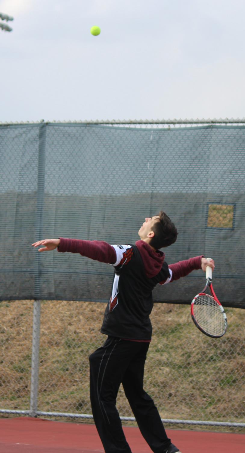 Andrew+serving+first+serve+of+the+match
