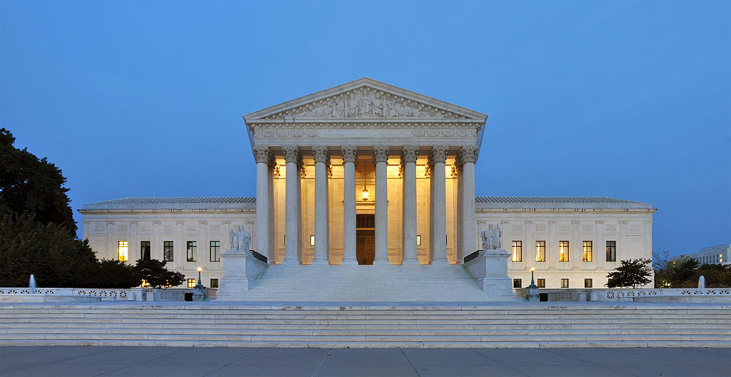 Panorama of the west facade of United States Supreme Court Building at dusk in Washington, D.C., USA.
