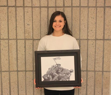 "Ariana Guerra proudly holds her stippling of ""Flag Raising on Iwo Jima."""