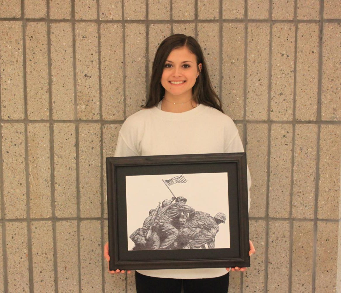 Ariana Guerra proudly holds her stippling of