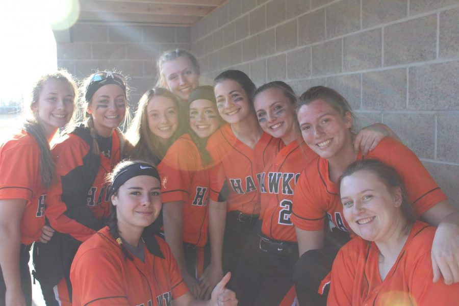 The+softball+team+is+all+smiles+at+their+game+against+Peters+on+March+27.+