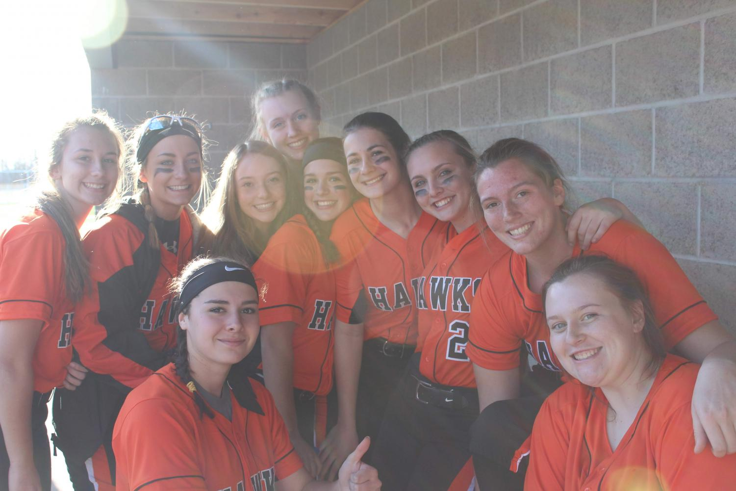 The softball team is all smiles at their game against Peters on March 27.