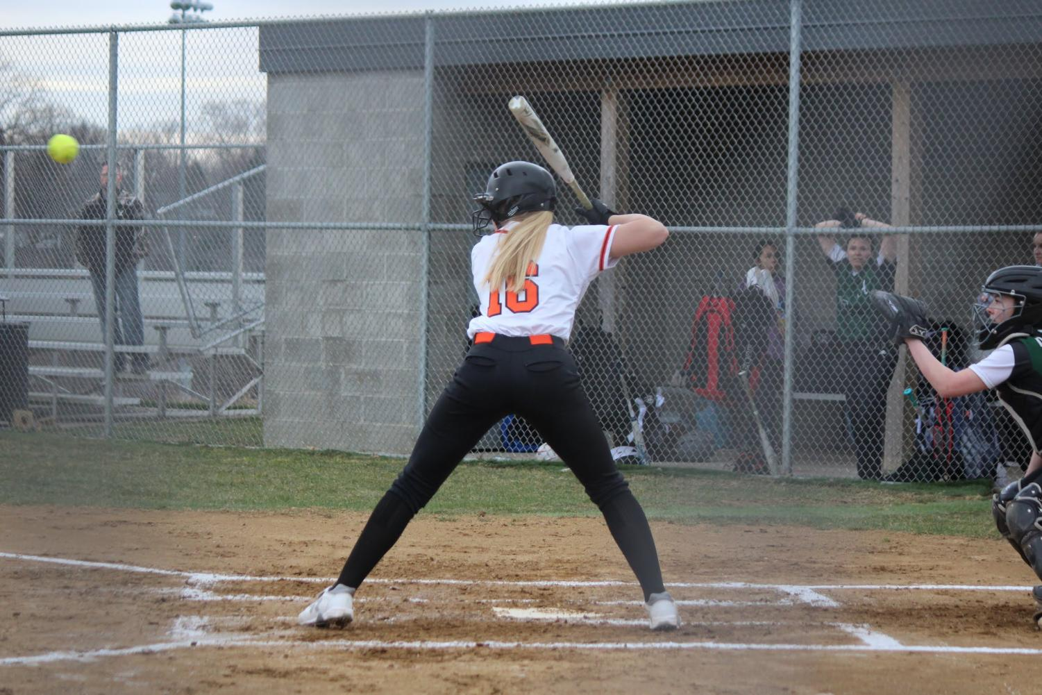 Reagan Milliken prepares to the hit during the Lady Hawks game vs. Allderdice on March 28.