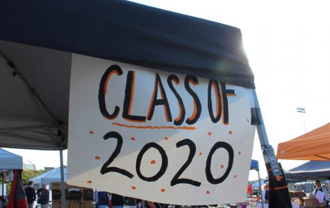 The Class of 2020 sign hands above the Junior Ways N Means' booth at Community Day.